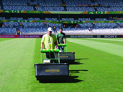 Groundsmen at Belo Horizonte Stadium preparing the pitches for the forthcoming World Cup using Dennis Mowers